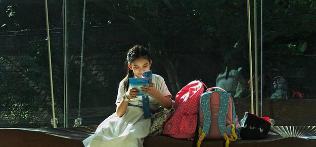 girl on bench reading photo
